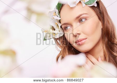 Fragile girl with natural makeup looking sideway