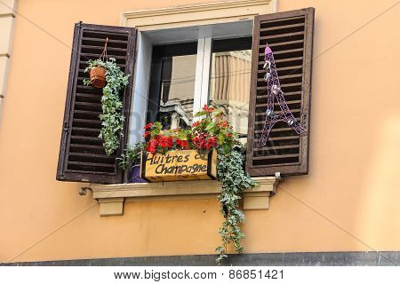 Decorative Box With Flowers Over French Food And Wine Shop