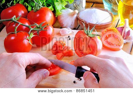 Chef Cutting A Tomato On A Cutting Board