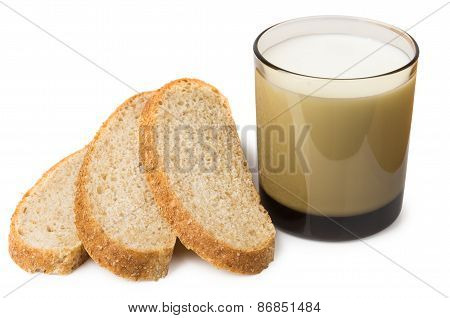Slices Of Bran Bread And Glass Of Milk