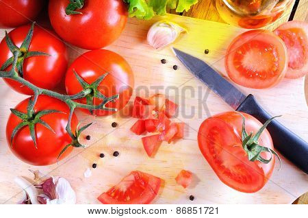 Tomatoes On A Cutting Board Top View