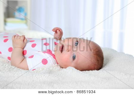 Cute baby girl, on white plaid background
