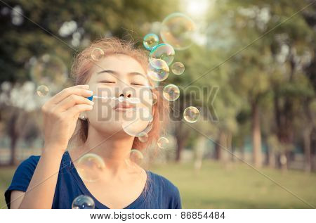 Young Woman Play Blowing Bubble Outdoor Lifestyle Vintage Color Tone