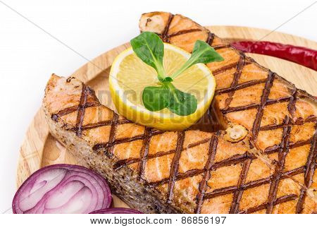 Salmon steaks on platter.