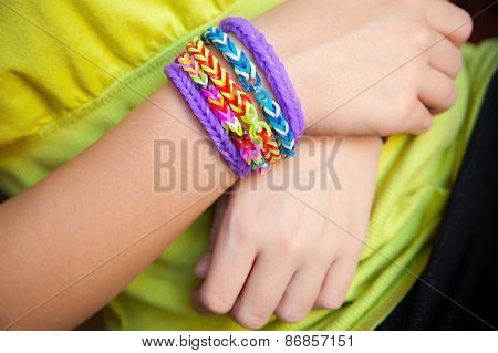 Child Hands With Colorful Rubber Rainbow Loom Band Bracelet