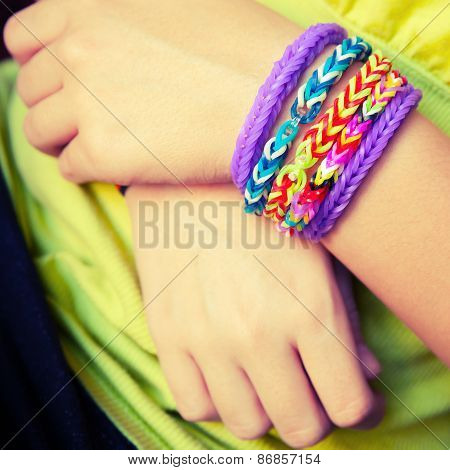 Child Hands With Colorful Rubber Rainbow Loom Band Bracelets