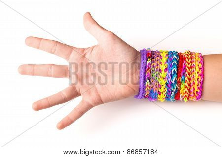 Hand With Colorful Rubber Rainbow Loom Bracelets On White