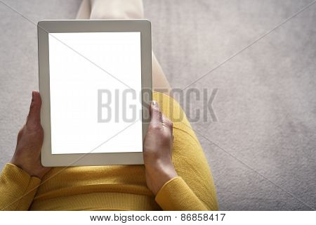 Woman on the sofa with tablet pc.