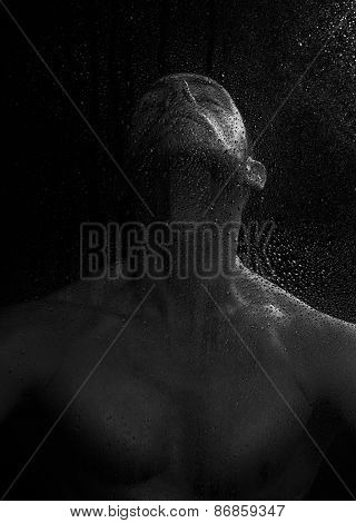 Man Behind Wet Glass
