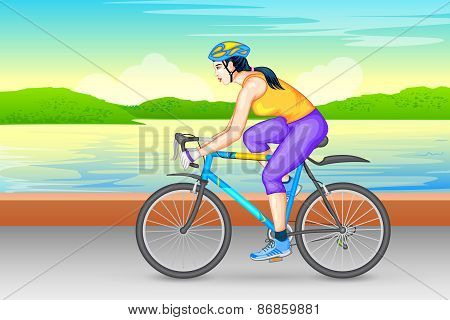 Lady cycling for fitness