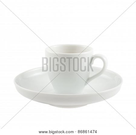 Ceramic cup over dish plate isolated