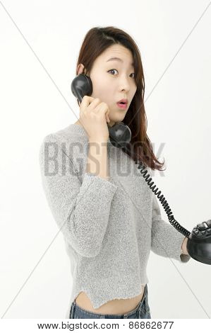 Asian woman talking by telephone