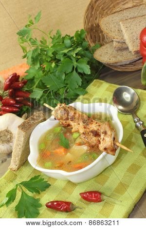 Poultry Consomme With Chicken Skewers