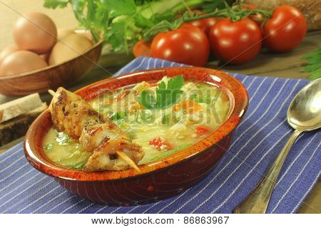 Chicken Soup With Chicken Skewers, Bread And Noodles