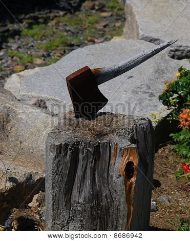 Antique Rusted Ax In Log