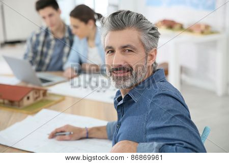 Portrait of smiling teacher in architecture