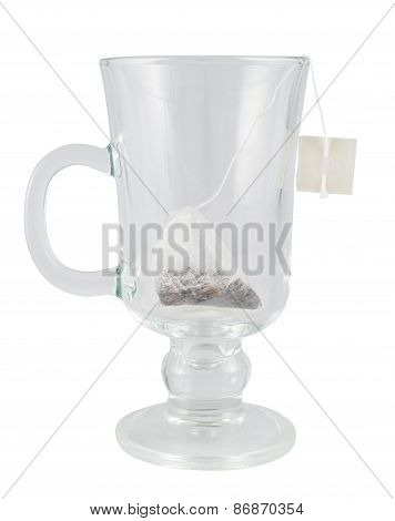 Glass teacup with a tea bag inside