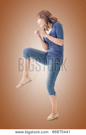 Fighting Asian woman, full length portrait isolated.