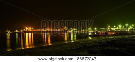 Panorama of sea port Burgas. Ships sand and reflections light.