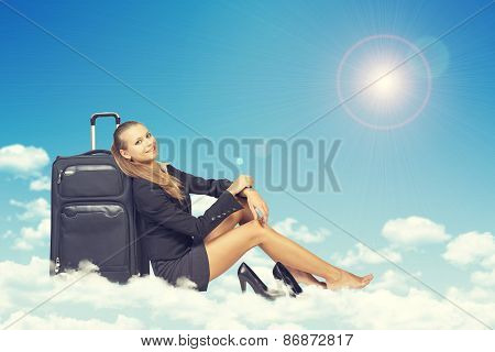 Woman sitting on clouds, leaning back in traveling bag, smiling