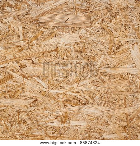 Pressed wood shavings fragment