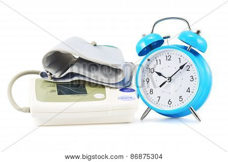 Alarm clock next to sphygmomanometer