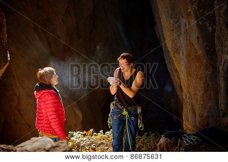 two climbers in a cave