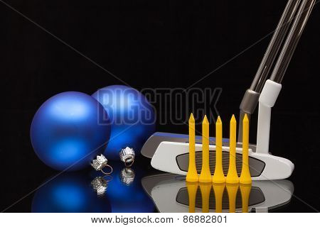 Christmas Decoration And Two Golf Putters