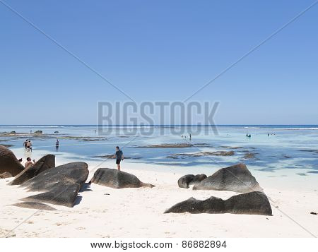 Tourists On The Beach Seychelles