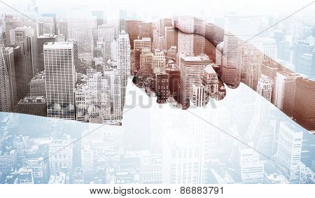 Close up of female and male hand shaking against high angle view of city