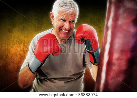 Portrait of a determined senior boxer against dark background