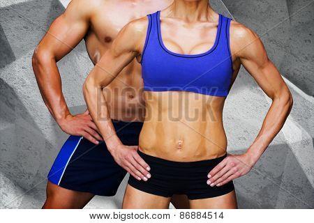 Bodybuilding couple against grey angular background