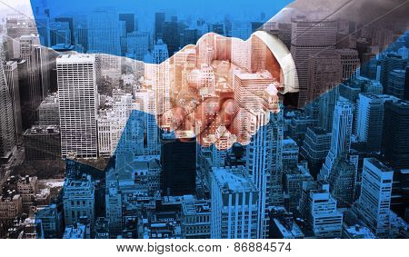 Handshake between two business people against high angle view of city