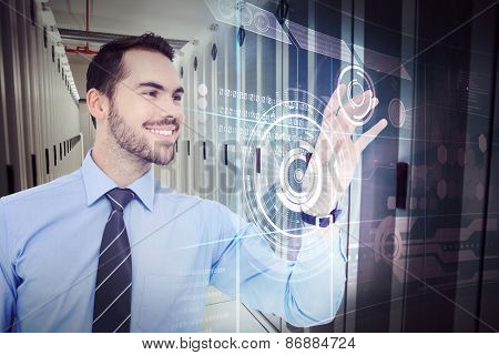 Happy businessman catching something with his hand against data center