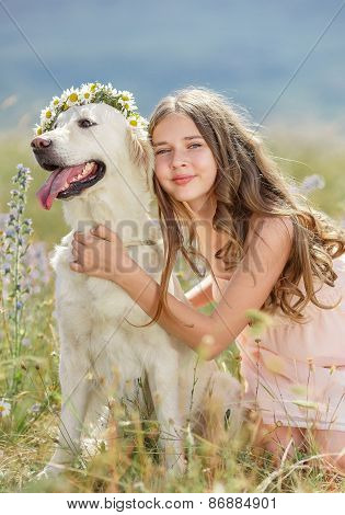 Girl playing with her dog outdoors