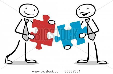 Two business people holding jigsaw puzzle pieces as concept for teamwork