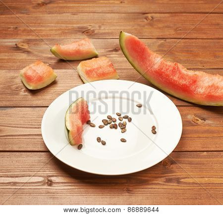 Slices of eaten watermelon composition