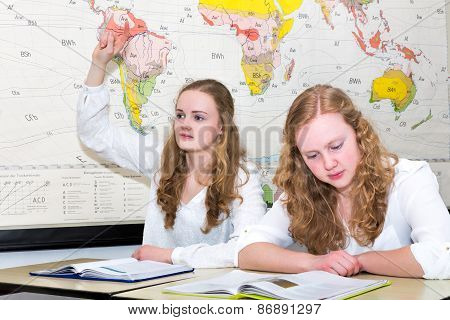 Dutch teenage girl with learn finger in geography lesson