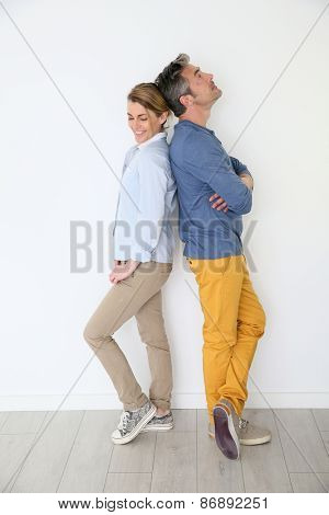 Cheerful mature couple on white background