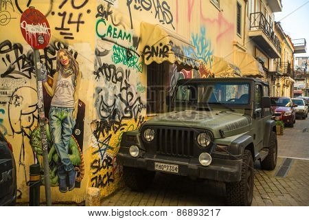 ATHENS, GREECE - APR 1, 2015: Contemporary graffiti art on city walls. Hardships of Greek economic crisis since 2010 have led to a new wave of graffiti - making Athens a new Mecca for street artists.
