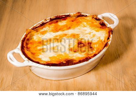 White Ceramic Dish Of Lasagna Straight From The Oven