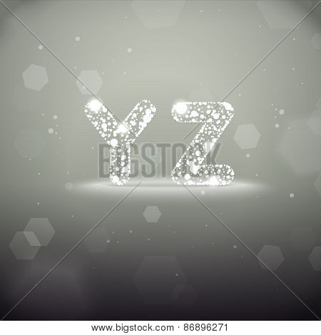 Glowing Letters Y to Z on Bokeh Background