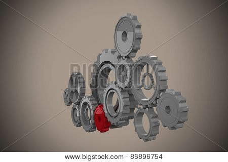 Cogs and wheels against grey background with vignette