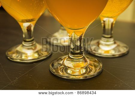 four glasses with light beer