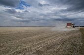 stock photo of spreader  - Liming action on the field in spring season - JPG