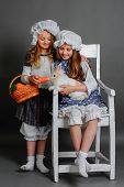 picture of rabbit year  - girls rustic with rabbit carrot and basket - JPG