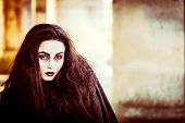 foto of scary face  - Girl with scary face painting and long hair outdoor - JPG