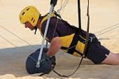 stock photo of glider  - hang glider preparing to launch from a sand dune - JPG