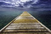 picture of dock  - An empty dock leading out of the blue tropical water on Mustique island - JPG