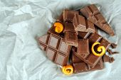 foto of orange peel  - Chocolate with orange peels on parchment - JPG